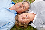 Portrait of lovely old couple lying on grass