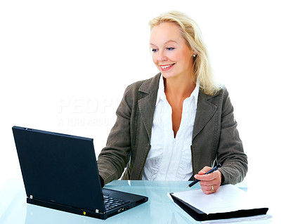 Buy stock photo Shot of an attractive businesswoman sitting in front of a laptop isolated on white