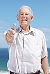 Excited old man showing thumbs up sign