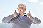 Confident old man showing thumbs up sign with both hands