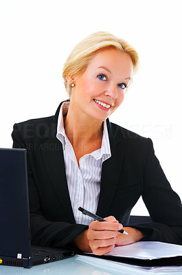 Buy stock photo Studio portrait of a mature businesswoman sitting at her desk with a laptop and paperwork