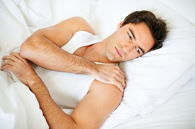 Young man wake up in morning on the bed