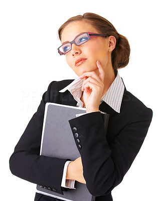Buy stock photo Portrait of a young businesswoman holding a folder, considering options.