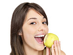 Closeup of a happy female eating a green apple