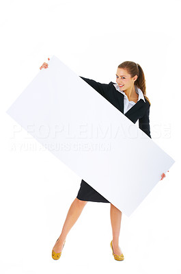 Buy stock photo Portrait of a beautiful businesswoman holding a blank billboard tilted. This isolate was taken in our studio.