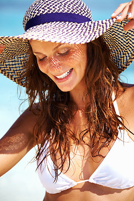 Relaxed woman in sun hat
