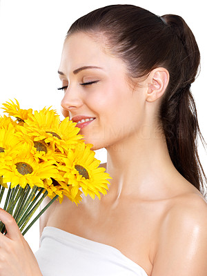 Buy stock photo Beautiful portrait of a young woman smelling flowers.