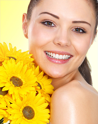 Buy stock photo Portrait of a gorgeous model with glowing skin with bright yellow flowers