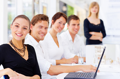 Buy stock photo Cropped shot of a group of coworkers sitting in a meeting