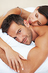 Relaxed couple lying in bed