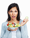 Surprised woman with salad