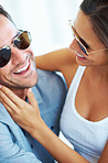 Couple in sunglasses having good time