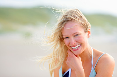 Buy stock photo Portrait of a lovely young smiling woman while at the beach