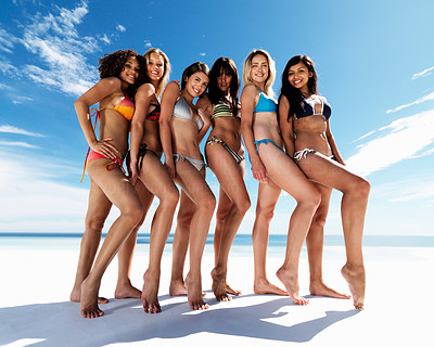 Buy stock photo Full length of a happy group of females posing in bikini at the beach