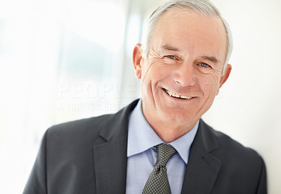 Closeup of a happy business executive giving you a smile