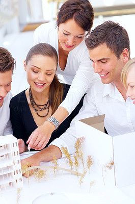 Buy stock photo Cropped shot of a group of architects discussing their latest building plans