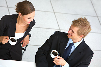 Buy stock photo Cropped shot of two colleagues doing business at a cafe