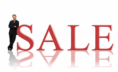Buy stock photo Young salesman leaning by sale sign over white background