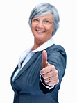 Business woman gesturing a success sign , focus on hands