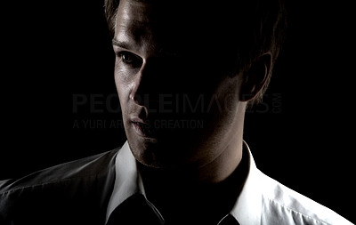 Buy stock photo Grunge portrait of businessman Experimental studio setup, with light coming from behind. This series is of a professional Danish Model.