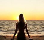 Beautiful woman in sunset by he ocean