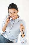 Business woman using cellphone in office