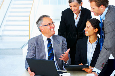Buy stock photo Mature businessman explaining the strategy to his corporate team - copyspace