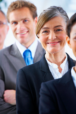 Buy stock photo Senior business woman - Mature business woman with her colleagues in the background