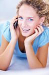 Closeup of a cute young girl talking on mobile phone