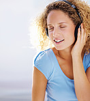 Portrait of cute young lady listening to romantic music