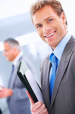 Buy stock photo Young business executive - Mature business man with his colleagues in the background