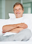 Relaxed happy senior man at home