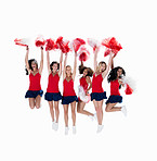 Squad of six cheerleaders jumping in the air against white