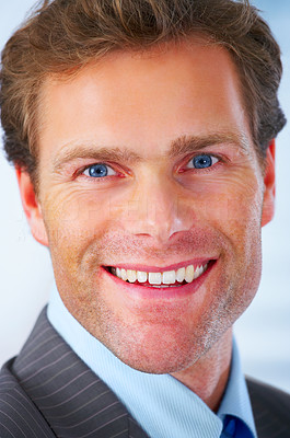 Buy stock photo Close up of a mature and attractive business man with a smile on his face