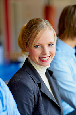 Buy stock photo A portrait of a smiling young female in a cafe surrounded by her friends. This could be a workplace, college or business setting.