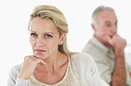 Relationship issues - middle aged  couple with hand on chin