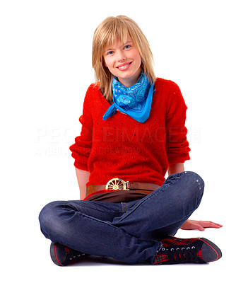 Buy stock photo Portrait of a happy young blonde girl smiling and sitting with legs crossed. Wearing blue scarf and red sweater. This collections unique keyword is: emma123