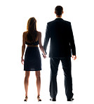 Rear view of a young couple holding their hands