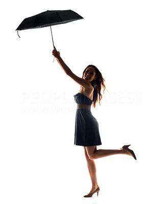 Buy stock photo Portrait of a beautiful young female holding umbrella up in air against white background