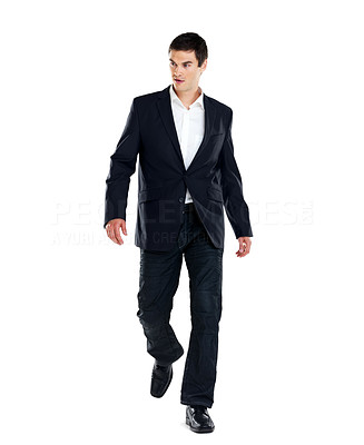 Buy stock photo Portrait of a handsome young business man walking on white background