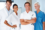 Group of successful young doctors standing together