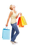 Happy young female with shopping bags on white