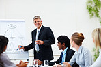 Mature business executive during a presentation with staff