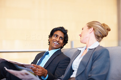 Satisfied business executives having fun during a pastime conversation
