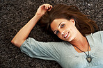 Young woman lying on the floor and smiling