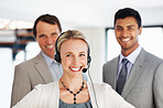 Lovely business woman in headphones with office colleagues
