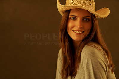 Buy stock photo Young lady wearing straw hat smiling against brown