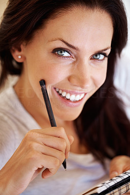 Attractive woman holding pen