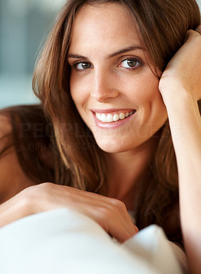 Buy stock photo Closeup of a beautiful young woman smiling naturally at you