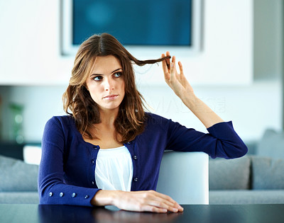 Buy stock photo Pretty young woman looking bored - Indoor